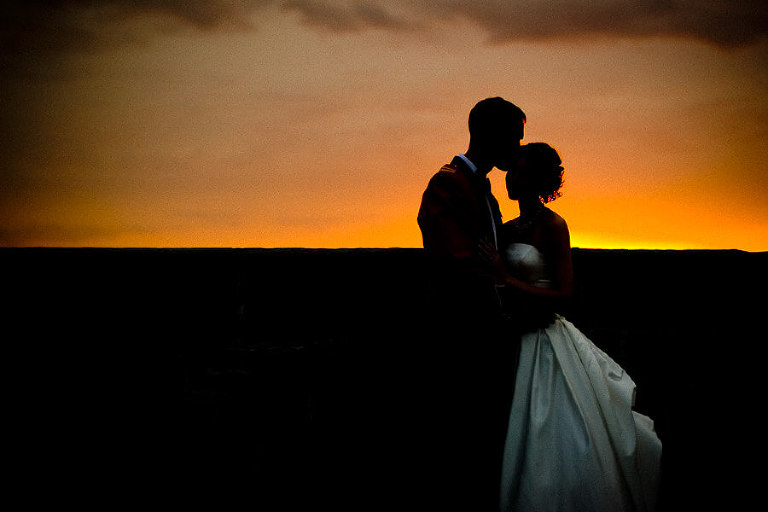 Fort Henry weddings - Silhouette couple with sunset behind