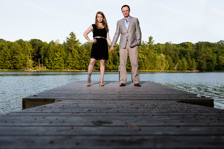 Outdoor engagement photos on a dock at Frontenac Park